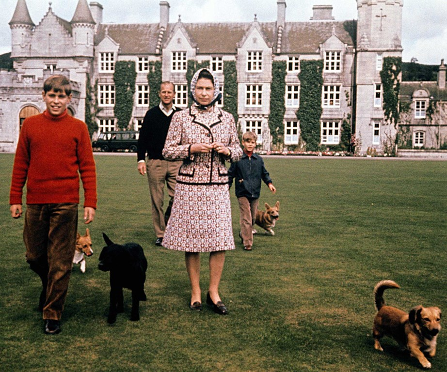 The Queen and Philip spent many summers with their family at Balmoral Castle. Here they're pictured with Prince Andrew (L) and Prince Edward (R) and all their dogs. *(Image: Getty)*