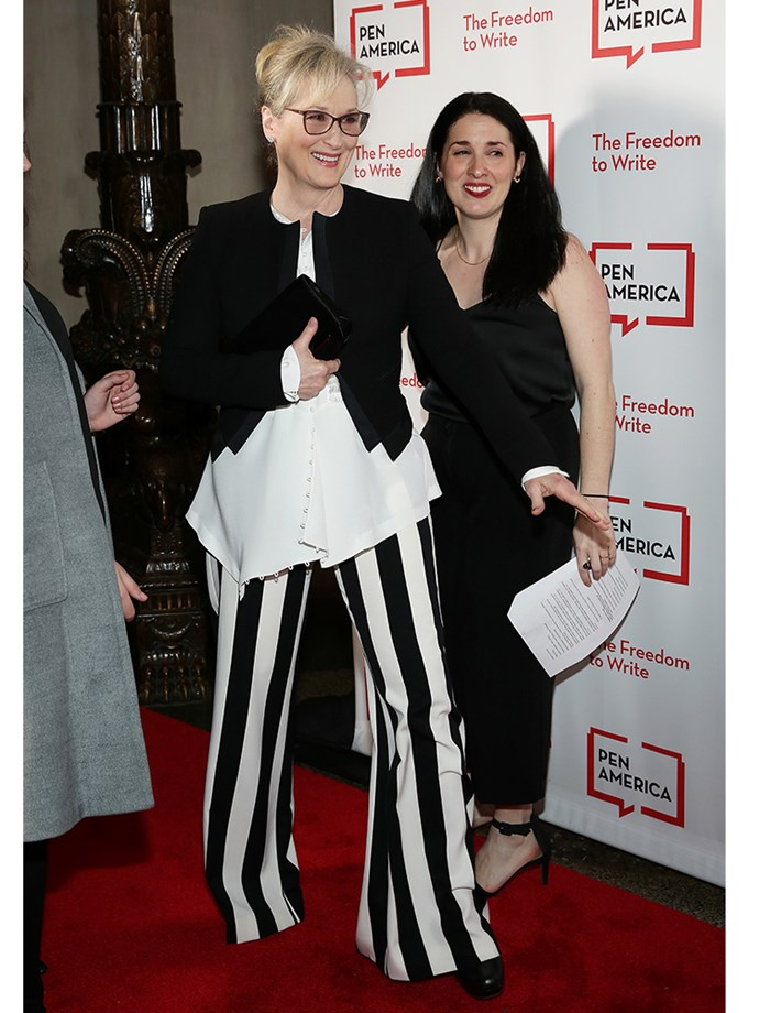 Meryl Streep defies fashion logic by making Beetlejuice trousers look chic, teaming them with a black blazer, white shirt, and retro spectacles.