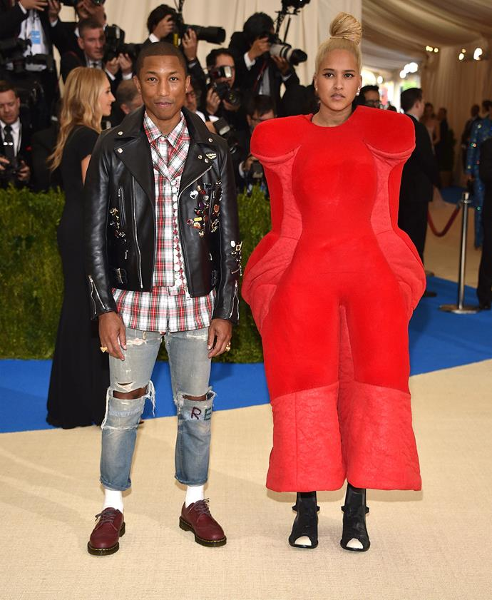 Pharrell and his wife Helen Lasichanh, wearing an outfit personally picked out for her by designer Rei Kawakubo.