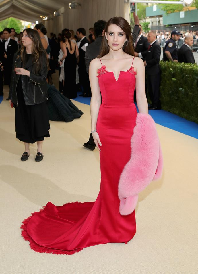 **BEST:** Emma Roberts also stood out with her crimson Diane Von Furstenberg gown, complete with pink fur stole.