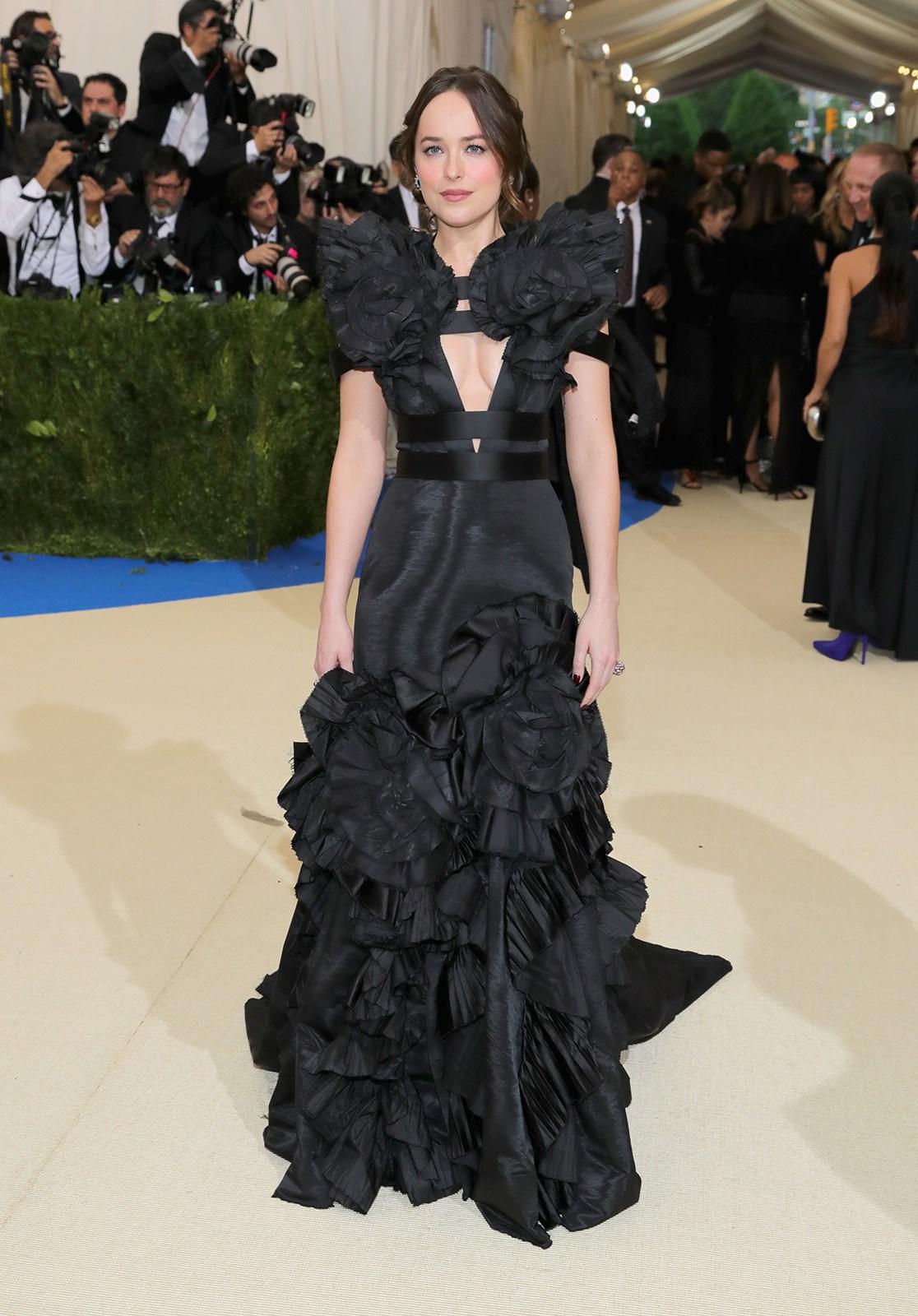 "**Jessica-Belle Greer, writer: Dakota Johnson in Gucci.** ""Dakota paid homage to Kawakubo's signature volumes and ruffles in a refreshingly dramatic dress."""