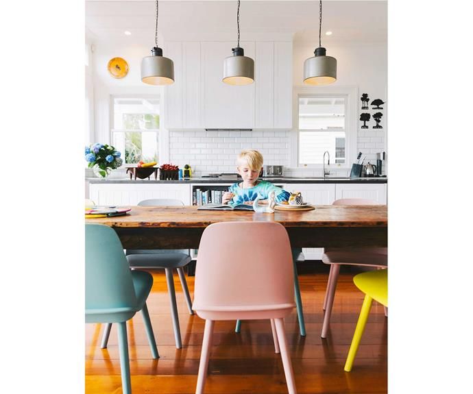 Darcy enjoys a boiled egg with toast soldiers at the 1800s French table from TheVitrine. The pastel-hued dining chairs from Muuto by Mika Tolvanen are from Nest and are available in Auckland at Bauhaus.   *Photos: Duncan Innes/proof agency.*