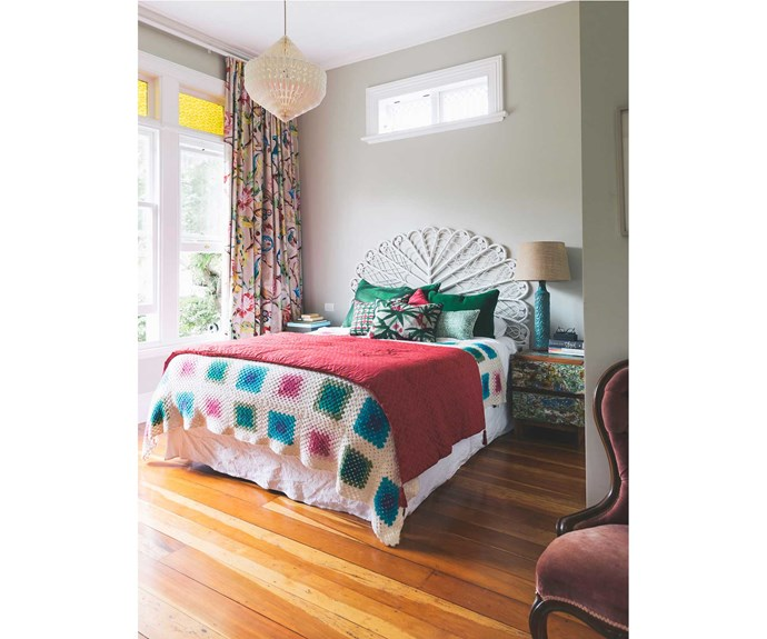 In the main bedroom, Kitchin selected James Dunlop Hampton Court curtains. The paper chandelier is from Iko Iko and the bedside table is from Republic. A friend of Kitchin's made the crochet blanket to match the curtains.  *Photos: Duncan Innes/proof agency.*