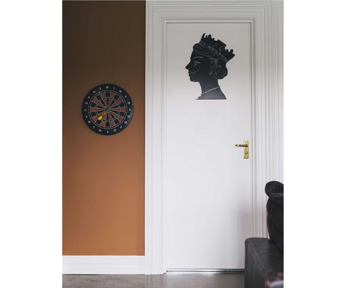 A blackboard of the Queen in silhouette and a magnetic dartboard are playful features in the rumpus room.   *Photos: Duncan Innes/proof agency.*