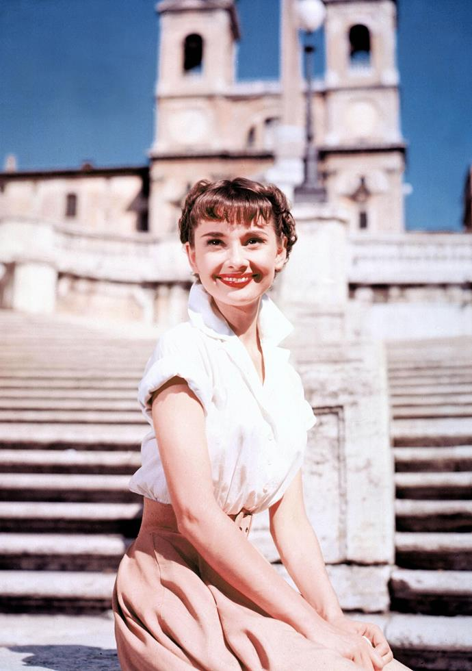 For those heading abroad and on the hunt for a capsule wardrobe, think 1950s midi skirt and blouse combo a la Audrey in *Roman Holiday*.