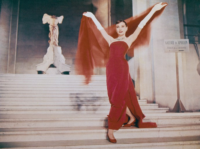 "Yes, we want every single item Hepburn wore in 1957 *Funny Face* (essentially a film in love with fashion), but that red dress and organza shawl designed by longtime collaborator Hubert de Givenchy is perhaps the most memorable.  ""His are the only clothes in which I am myself. He is far more than a couturier, he is a creator of personality,"" Audrey said of Givenchy.  If there was ever a person to persuade as to jump on the red trend band wagon…"