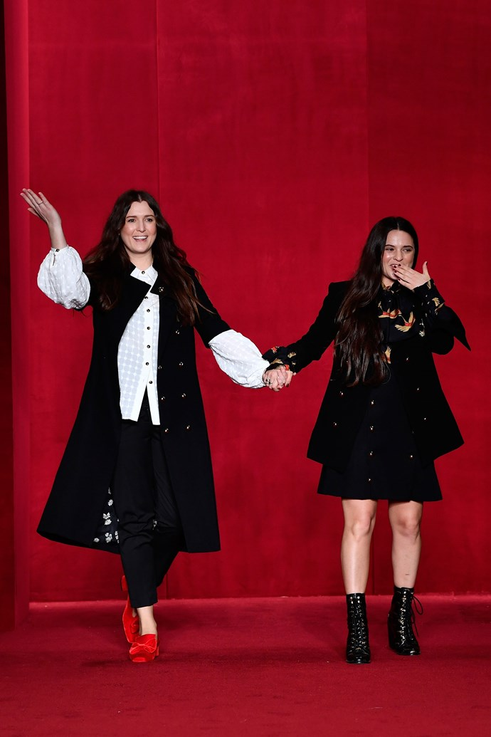 Designers Tessa MacGraw and Beth MacGraw close their show in their own designs.