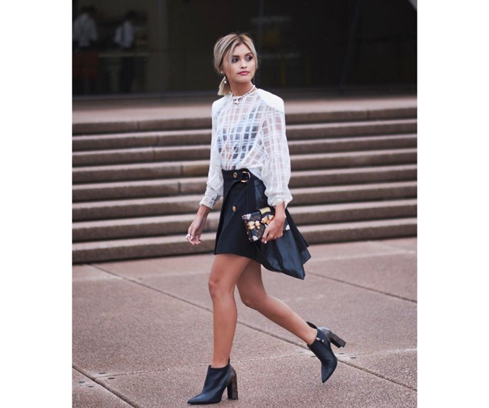 Sarah Hellen outside the Sydney Opera House in Louis Vuitton outfit and Tiffany & Co jewels.