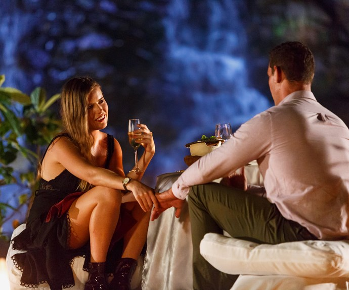 The duo enjoy a candlelit dinner outdoors in Thailand.