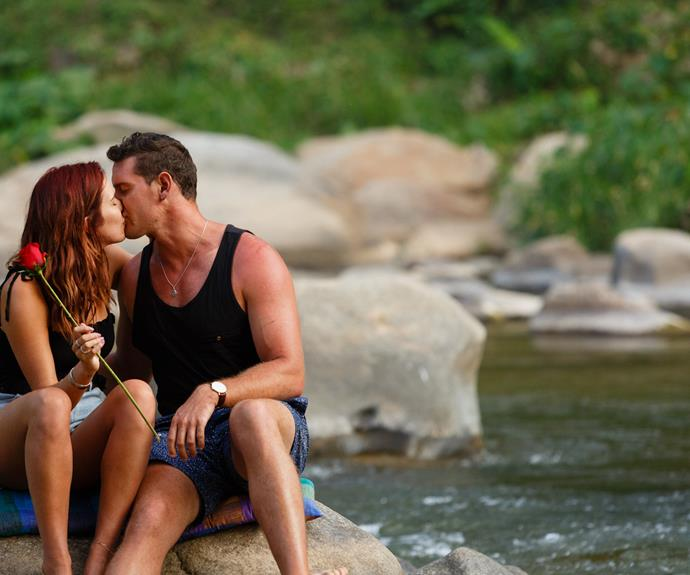 The pair share a smooch during a one-on-one moment after a group rafting date.