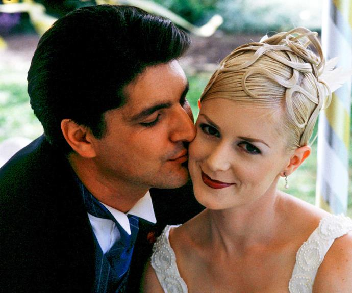 **Johnny & Tiffany: February 20, 1998** After divorcing cheater Chris Warner a couple of years earlier, Tiffany fell in love with handsome Dr Johnny Marinovich (Stelios Yiakmis). Their wedding was a grand affair at Johnny's family vineyard, but the happiness didn't last. Tiffany died in a tragic fall and bereft Johnny became a single dad to their daughter Maria.