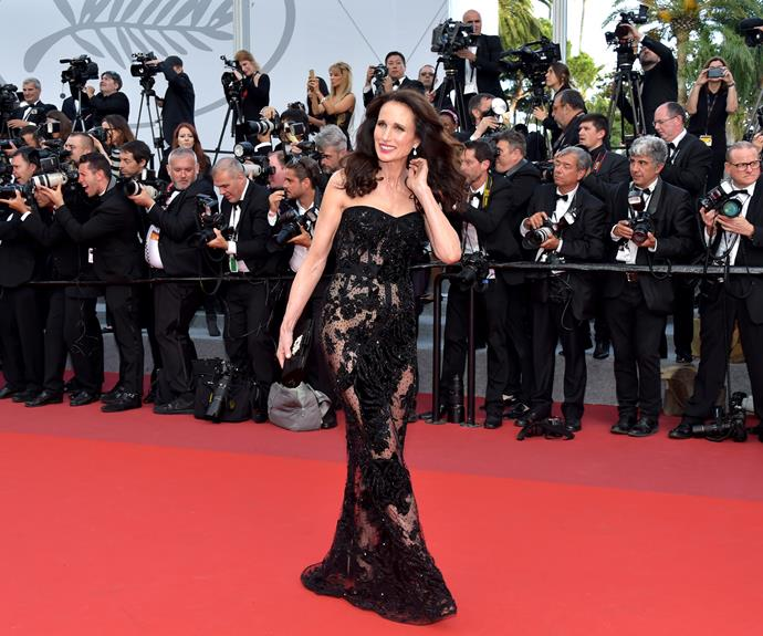 Andie MacDowell shines in Roberto Cavalli Couture - can you see the sparkling tigers hand-sewn onto her dress?