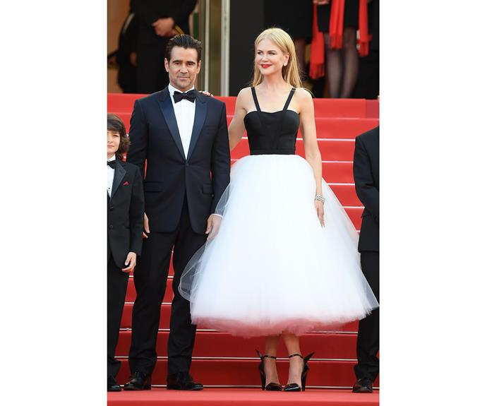 Nicole Kidman leans on Colin Farrell in a dress by Calvin Klein by Appointment that took 150 hours and 180 yards of silk tulle to make.