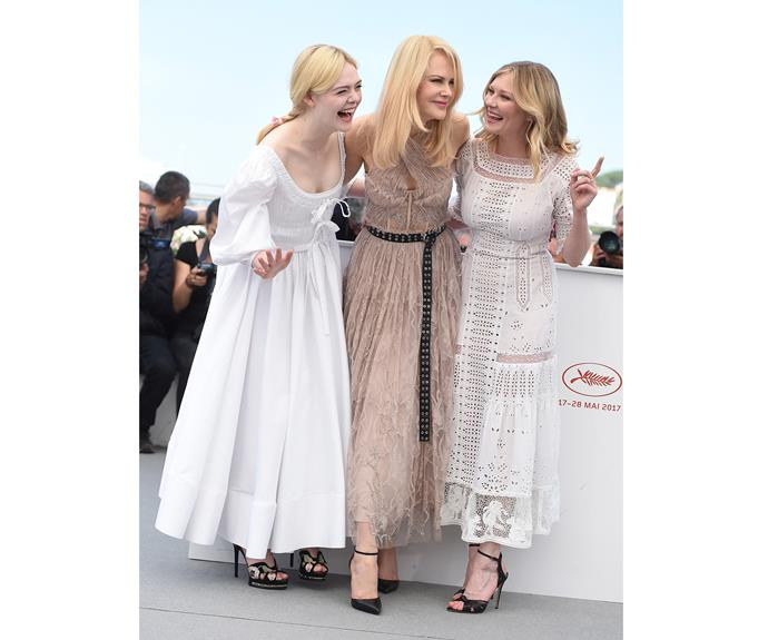 Elle Fanning and Nicole Kidman in Alexander McQueen and Kirsten Dunst in Loewe are a tri-factor of style at a photo call for *The Beguiled*.