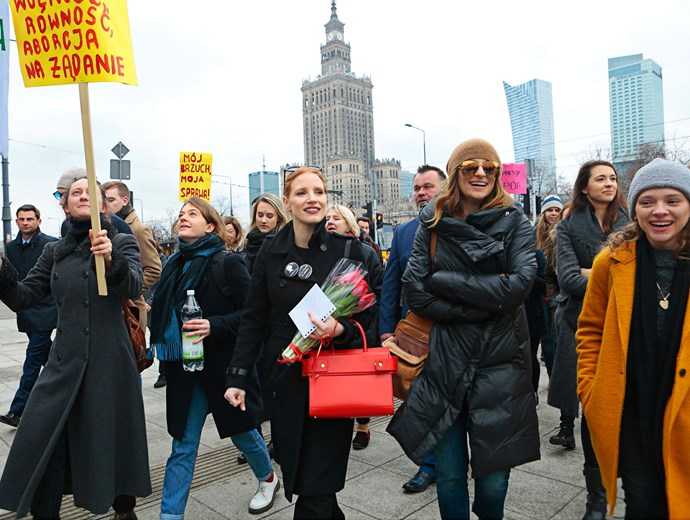 Niki and Jessica Chastain take to the streets in Poland to march for women's rights.