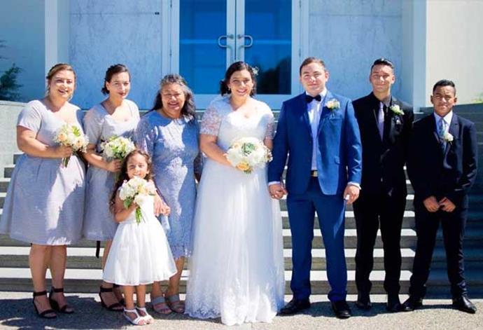I'm living my dreams! Julie as a blushing bride on her big day with (from left) Tracey, Emma, Ada, Savita, Teina, Jesse and Lincoln.