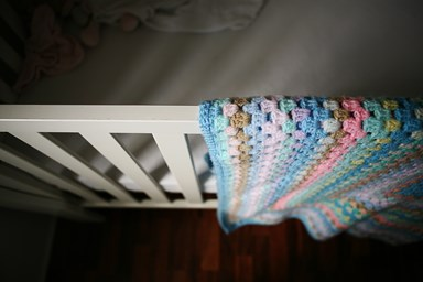 Grieving mother warns parents about using blankets in their baby's cot