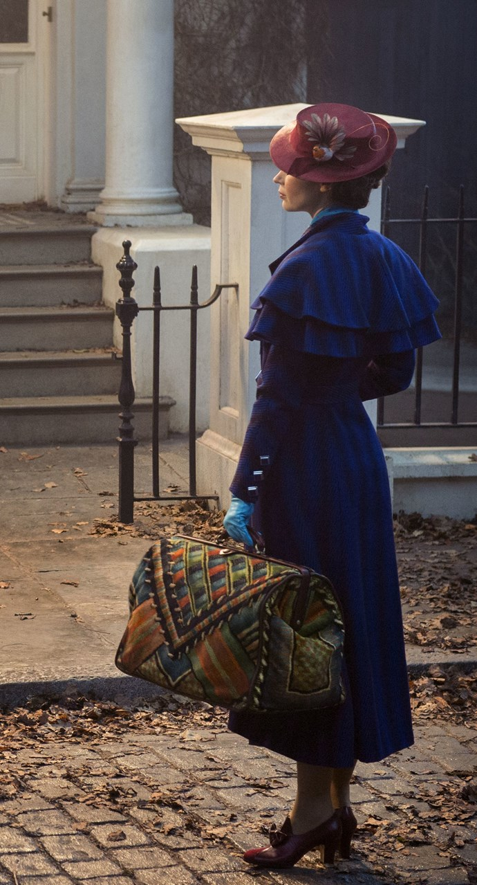 Emily Blunt clutches the iconic carpet bag and dons a familiar red hat in the first official image released from the film. Photo: Disney