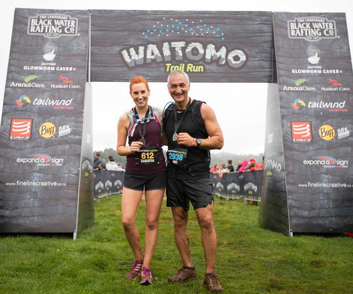 The grinning pair pose at the Waitomo Trail Run.