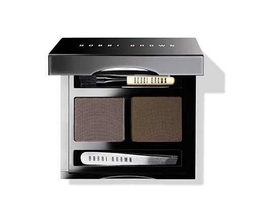 **Bobbi Brown Dark Brow Kit** Kate is renowned for her statement brows, which are enviously full and thick. But what does she fill them in with? The Bobbi Brown Dark Brow Kit, apparently!
