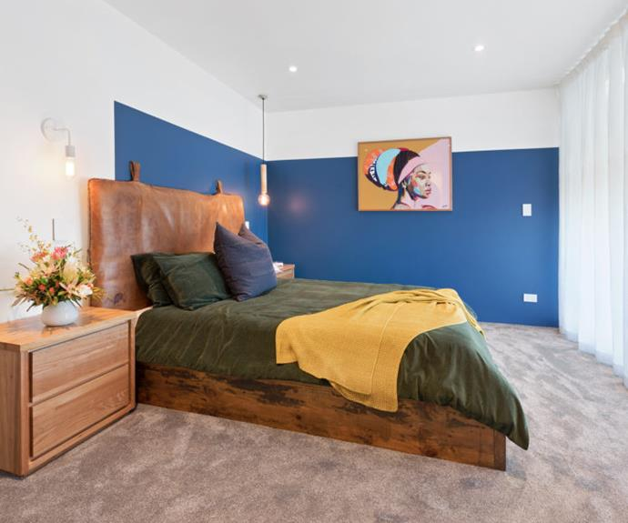 **Andy and Nate:** The Hamilton dads continued their signature colour effect into the master bedroom, using a bold blue on three-quarters of the wall.