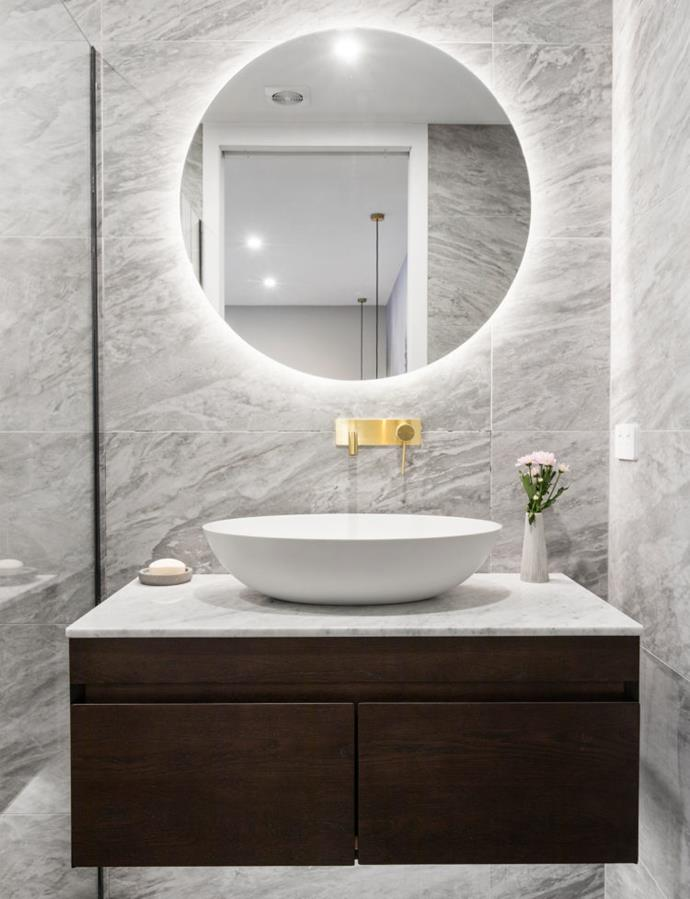 The twins decided to use the same statement diamond tiles and gold tap ware from their first winning bathroom.