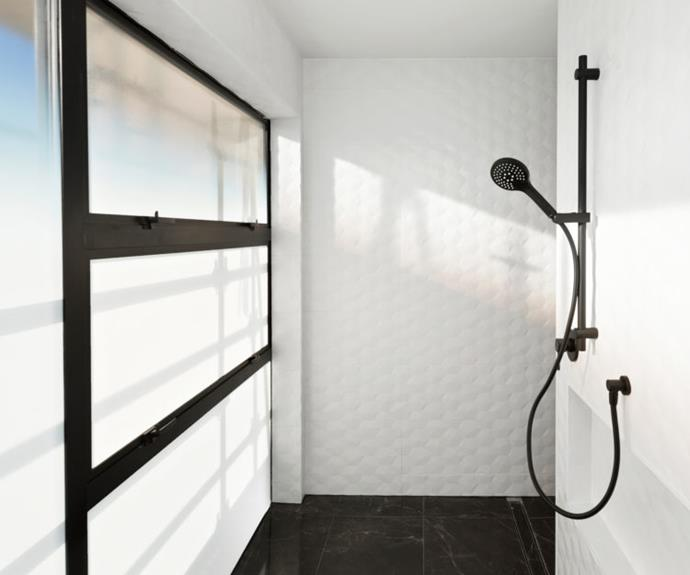 Matte black tapware features in the wet room.