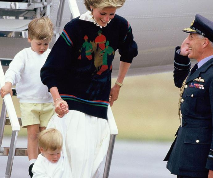 Diana giggles as she helps Harry down the stairs of the plane.