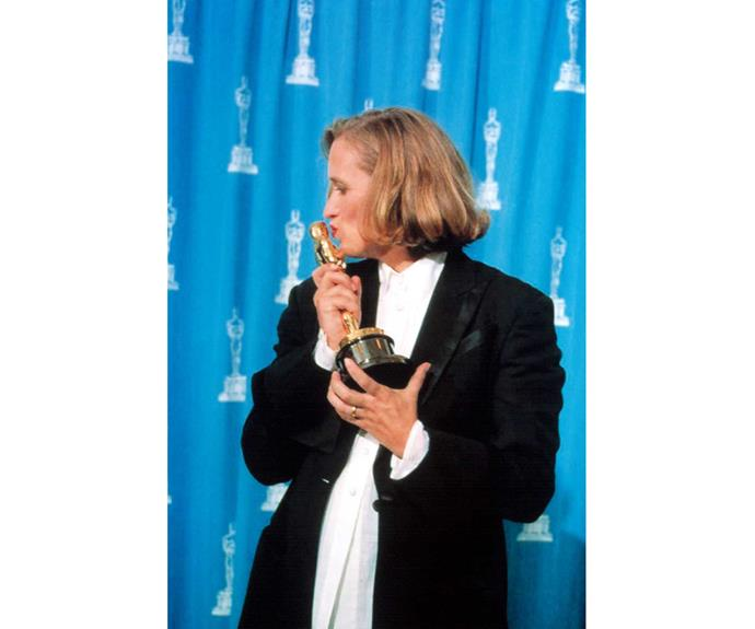 Kissing her Best Screenplay Academy Award for *The Piano*.