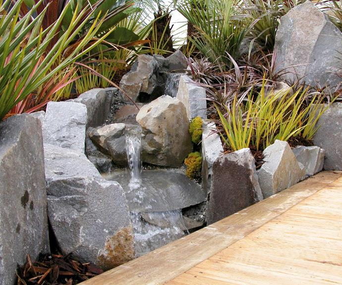 A water feature should have flat rocks to act as observation points and give easy access for drinking.