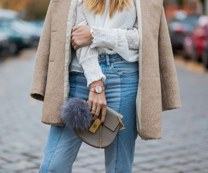 A fashion blogger wears a vintage coat with current season H&M jeans, Chloe bag and Zara blouse.