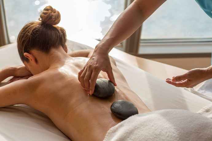 Treat yourself to a pedicure or massage experience aboard the Pacific Jewel.