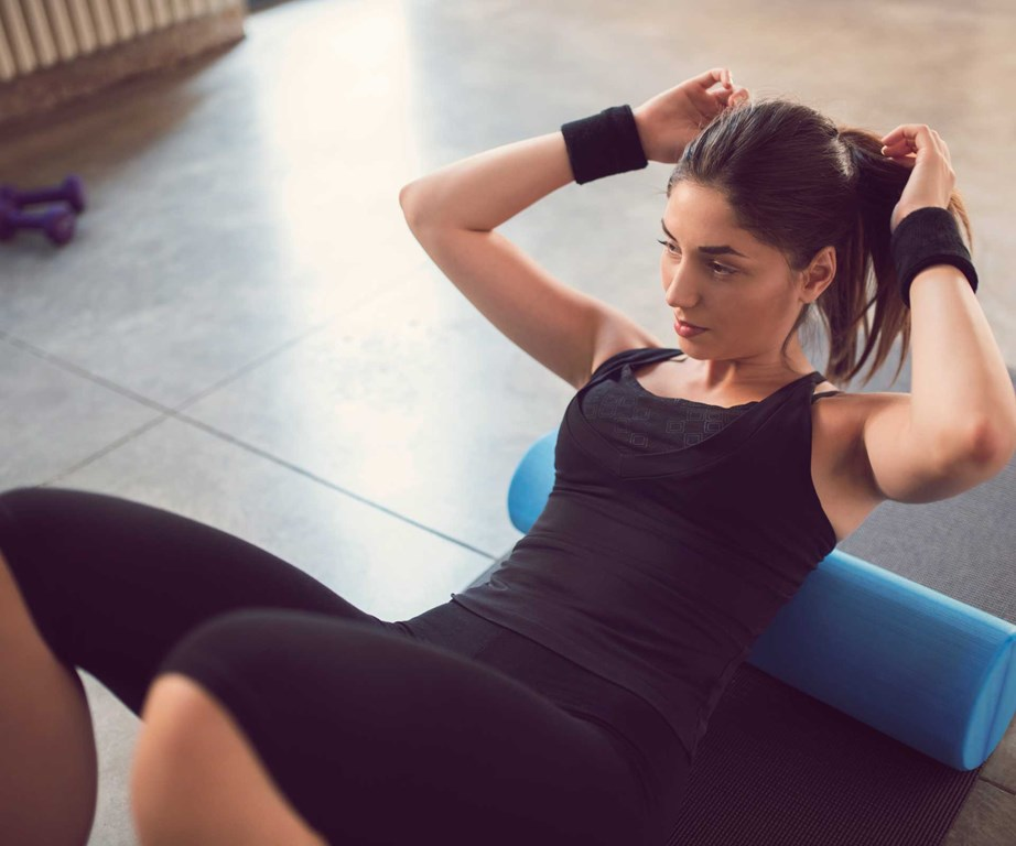 Foam rolling after you work out is a great way to ease knots and aids in better recovery, but there are also a whole lot of benefits to rolling pre-workout too! *(Image: Getty)*