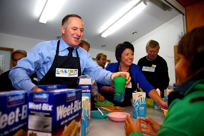 With former Prime Minister John Key, serving breakfast to school children in West Auckland.