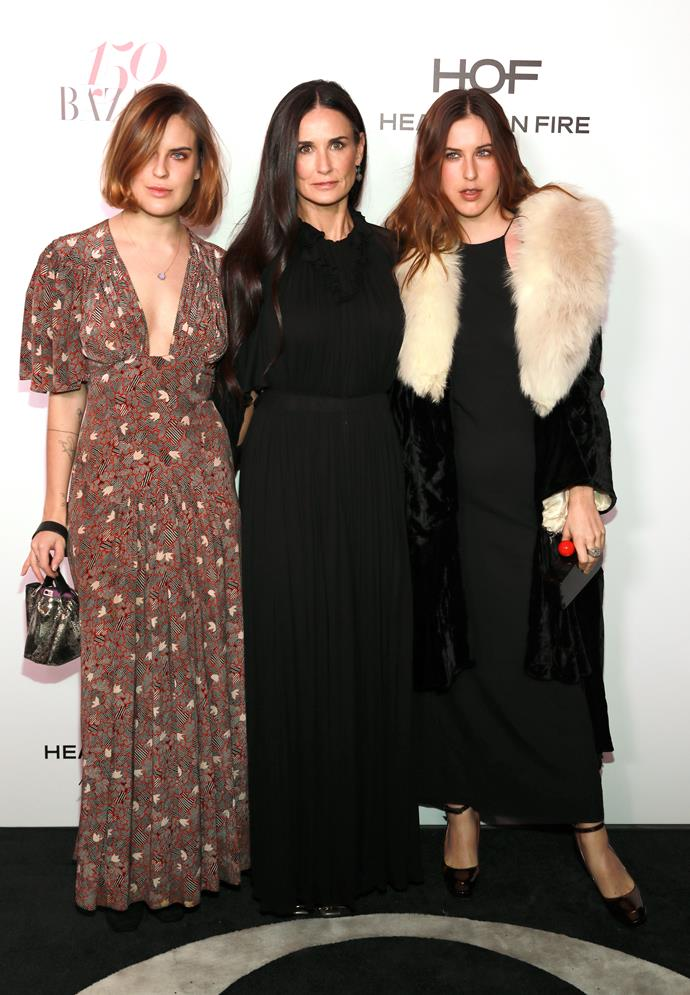 Scout Willis (far right), pictured here with her sister Tallulah Willis and mother Demi Moore has a unisex name from our list.
