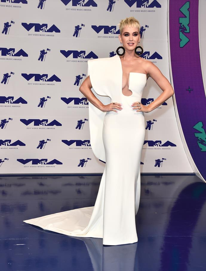 **BEST - Katy Perry:** The host of the evening glammed it up for her red carpet look in this sleek one-shouldered white gown.