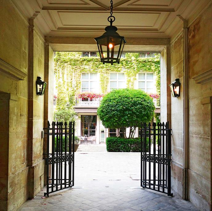 The entrance to Le Pavillon de la Reine hotel, as seen from Place des Vosges, which is a pretty spot to relax and people-watch.
