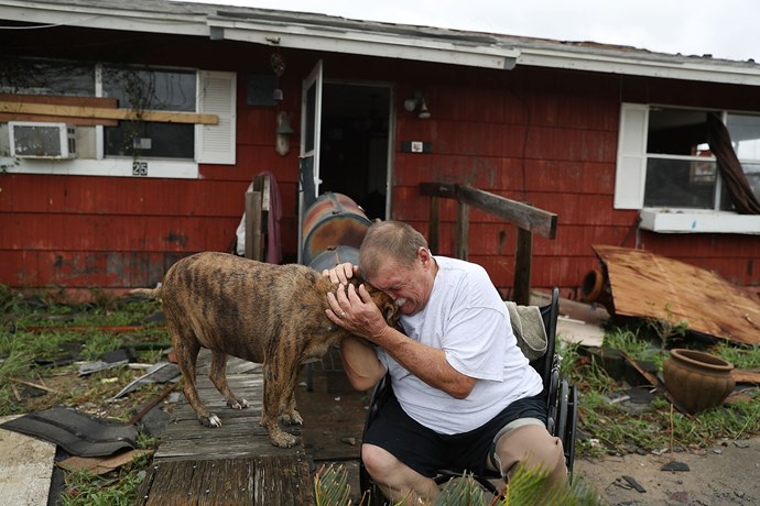 Steve Culver cries with his dog Otis in Rockport.