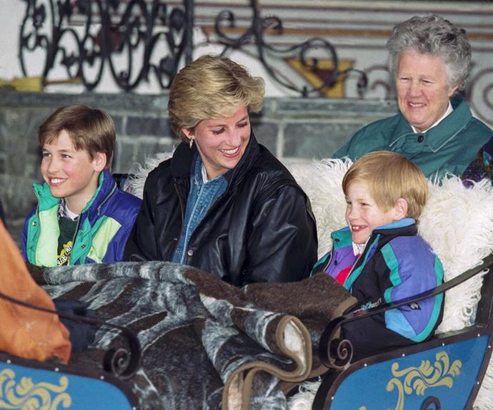 Harry, William and Diana are pictured with their nanny Olga Powell in the background.