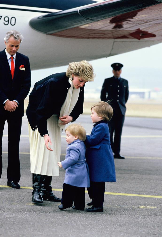 Diana walks with her sons at the airport in Aberdeen, Scotland in 1986.