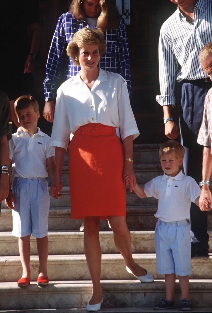 Diana holds tightly onto her boys' hands as they pose on the steps of the palace in Majorca in 1988.