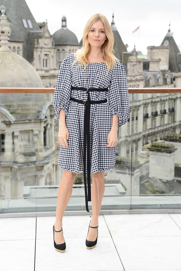 Sienna Miller was cute as a button in a gingham frock in London.