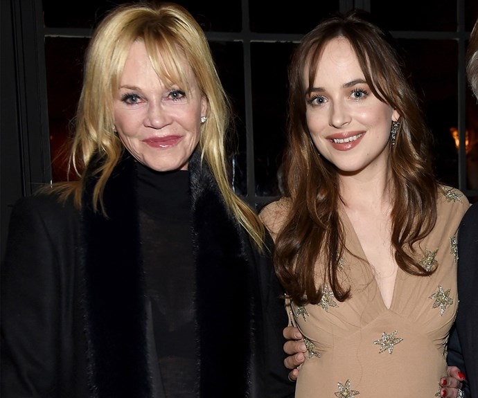 Melanie Griffith and her daughter, *Fifty Shades of Grey* star Dakota Johnson cuddle up at the *How To Be Single* New York Premiere in 2016.