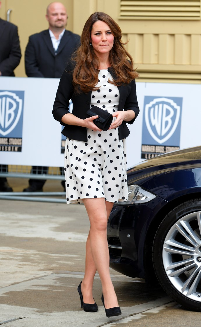 In April 2013, when the Duchess of Cambridge was pregnant with Prince George, she wore an adorable polka-dot number from Topshop to attend the opening of the Warner Bros. Studio.