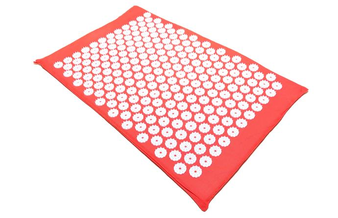 "An acupressure mat, also known by the brand names of Shakti mat, Pranamat or Spoonk mat just as tissues are often called ""kleenex""."