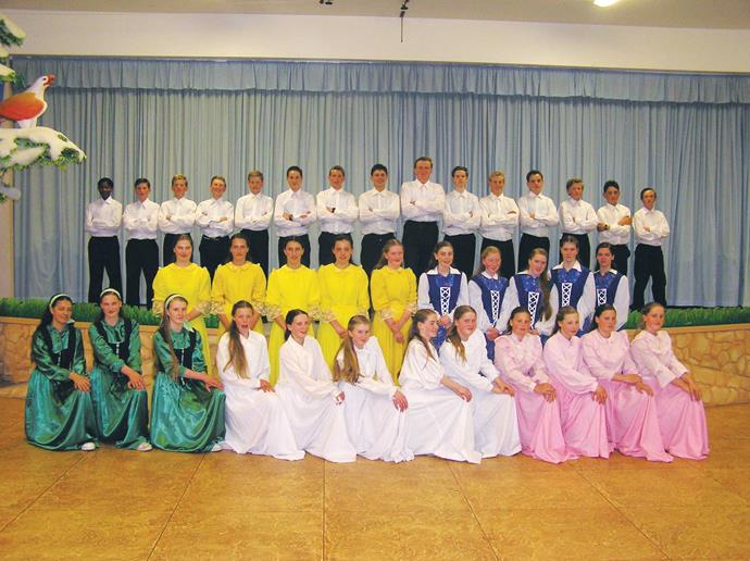 In yellow, third from left, before a recital.