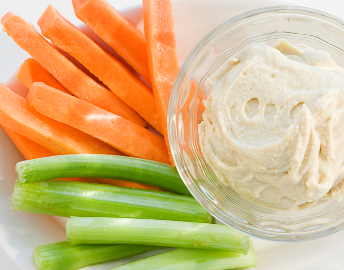 **Swap your snacks** Try carrot and celery sticks with plain hummus for a pre-dinner snack instead of cheese and crackers – such an easy and delicious way to reduce your calorie intake.