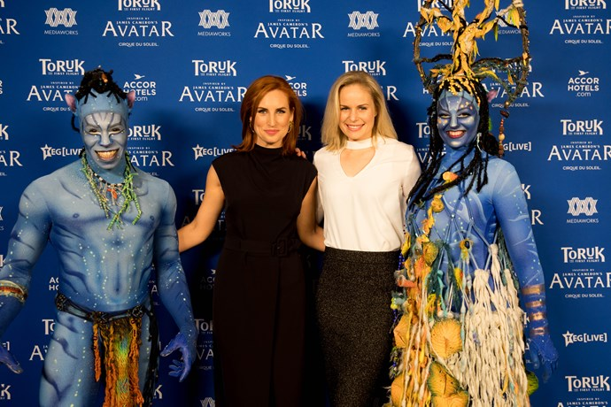 TV presenter Sam Hayes and Penny Ydgrem with Toruk performers.