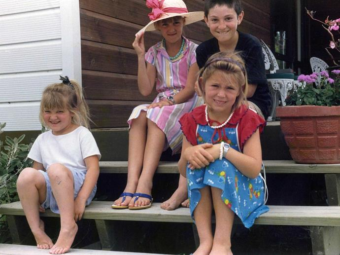 Jacinda (right, in red and blue) at age 7