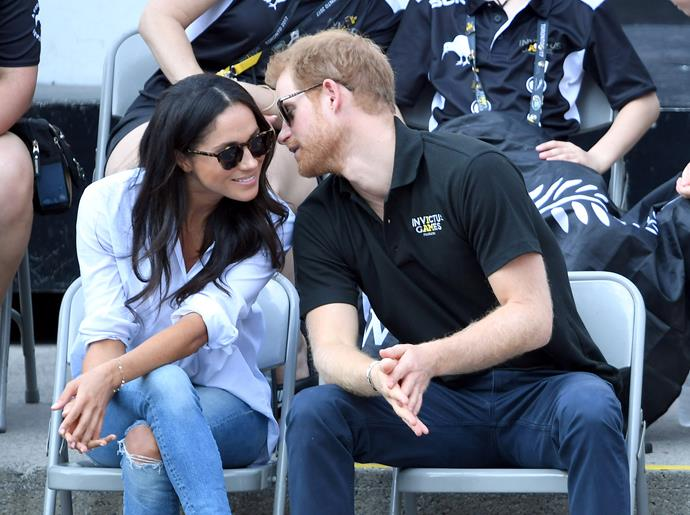 Prince Harry whispers to girlfriend Meghan Markle at the Invictus Games.